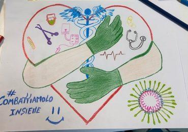 Coronavirus: il simbolico abbraccio di 8 infermieri. 1